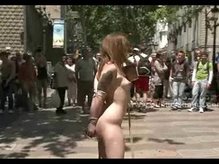 Brunette in outdoor public humiliation